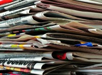 Newspapers w/inserts - No bags or other kinds of paper.