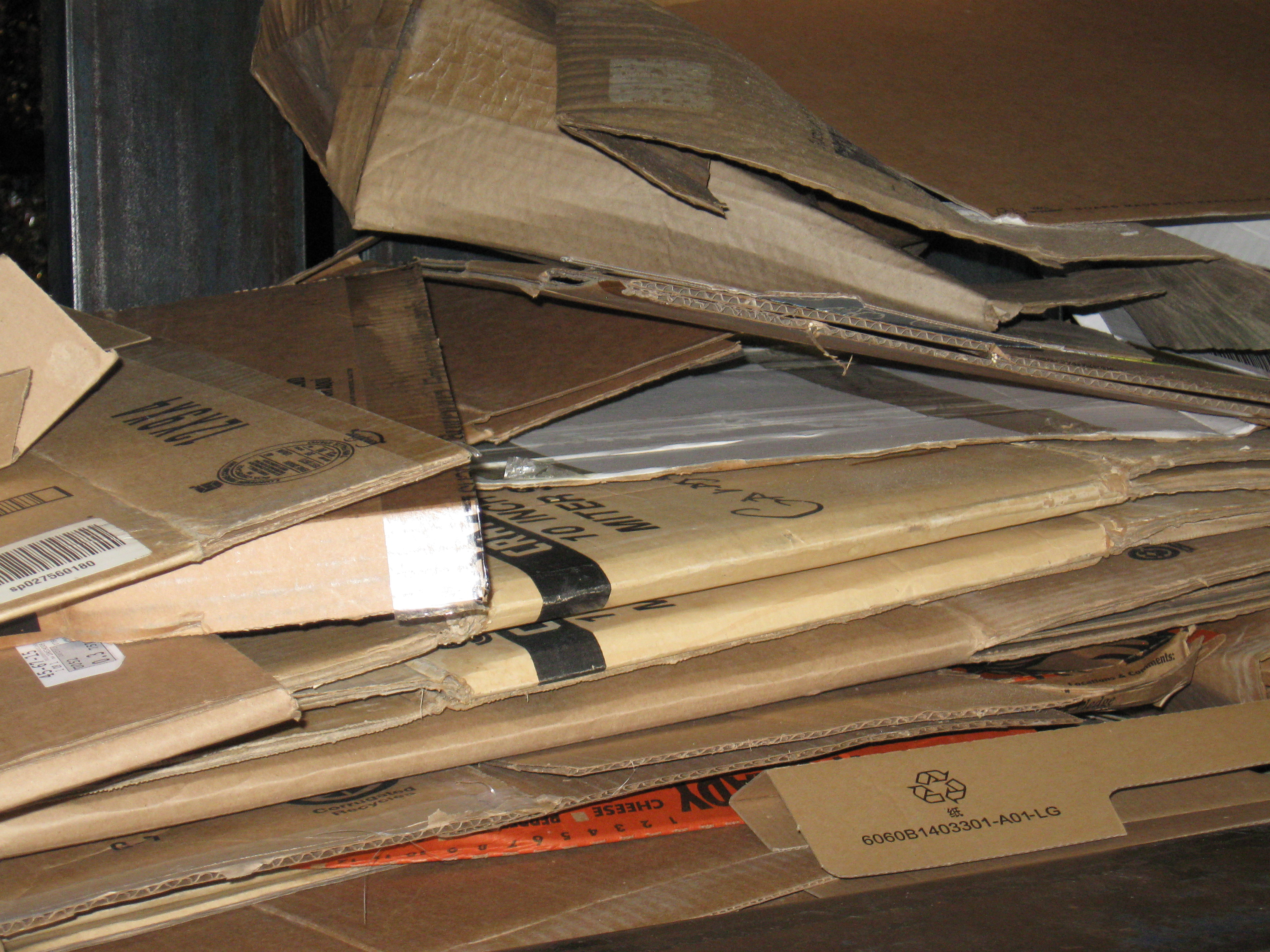 Cardboard - heavy corrugated boxes and brown paper bags. Remove packing and bags.